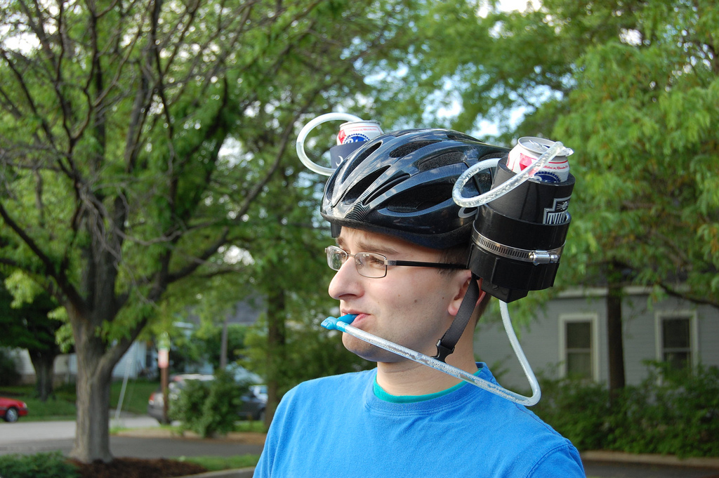http://ihatebicyclists.files.wordpress.com/2012/07/beer-helmet-bike.jpg